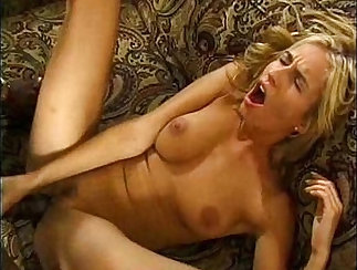 Beautiful blonde stunner sucks two cocks deeply in an interracial porn video