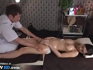 Alluring big-tits Japanese babe loves to massage dudes shaft