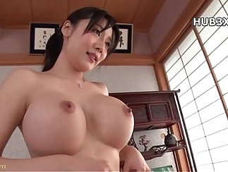 Asian brunette babe moans with pleasure as she shows ass