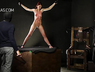 Athletic redhead getting punished