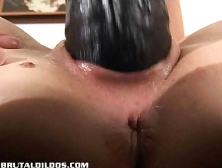 Amateur blonde hunk puts a dildo in pussy