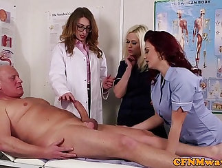 Clothed femdoms sucking doctors dick