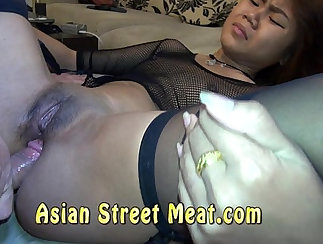 Asian gal with black hair fucks in missionary pose