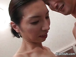 Asian mature puts her loving hands to work